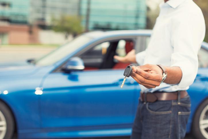 Male hand holding car keys